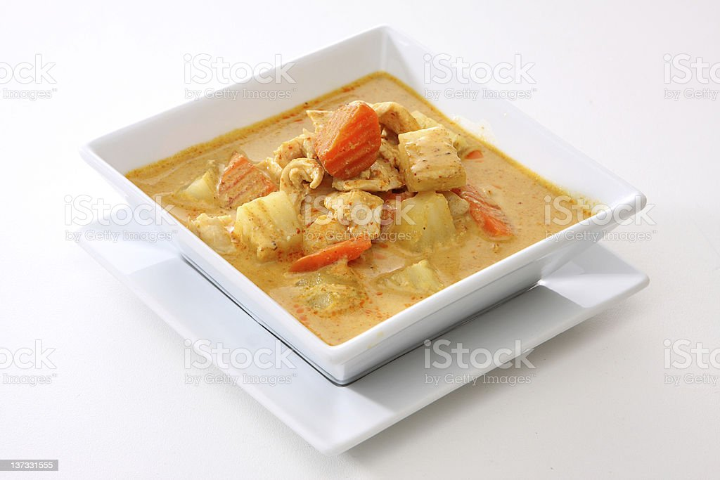 Square white bowl with chicken curry stock photo