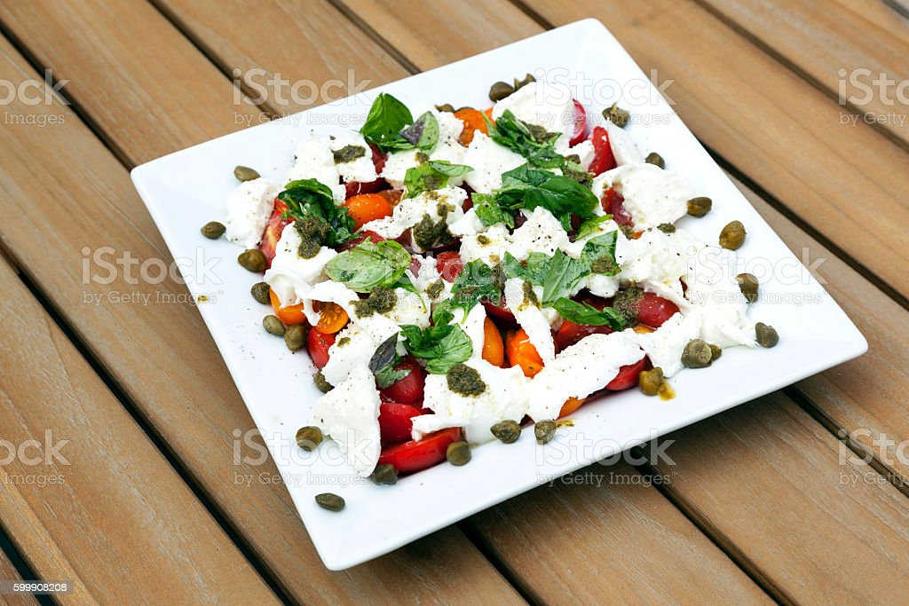 Square White Plate With Caprese Salad And Capres Stock Photo & More