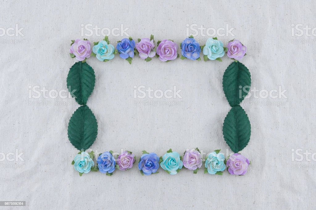 Square wreath made from blue tone rose paper flowers and green leaves...