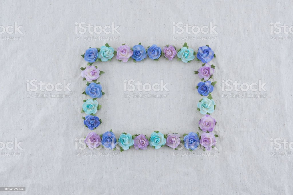 Square wreath made from blue tone rose paper flowers on muslin fabric...