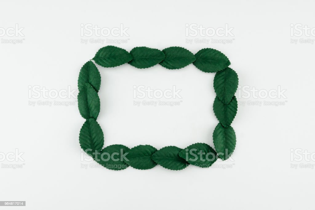 Square wreath made from green paper leaves royalty-free stock photo