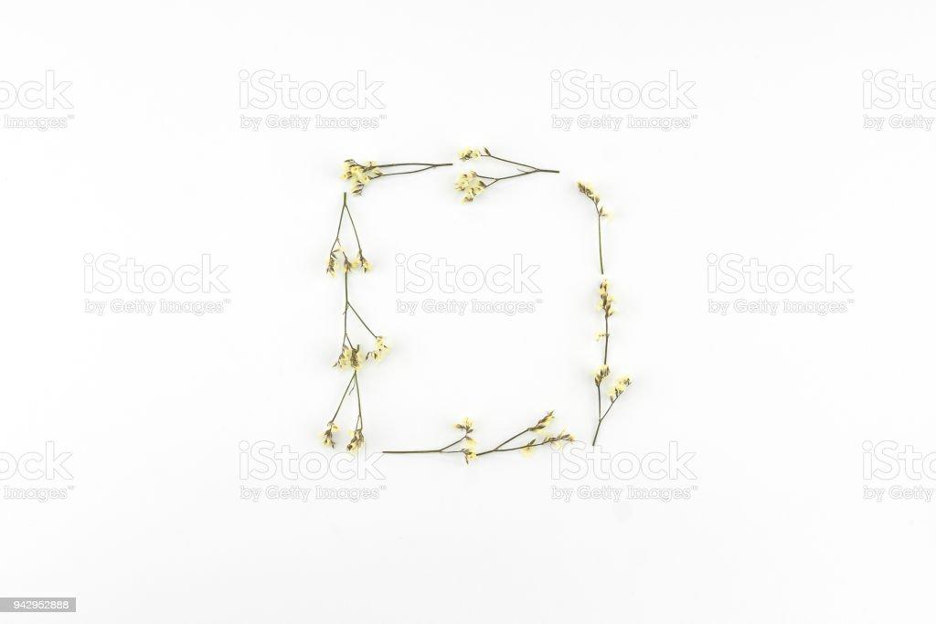 Square wreath made from yellow limonium caspia flowers stock photo