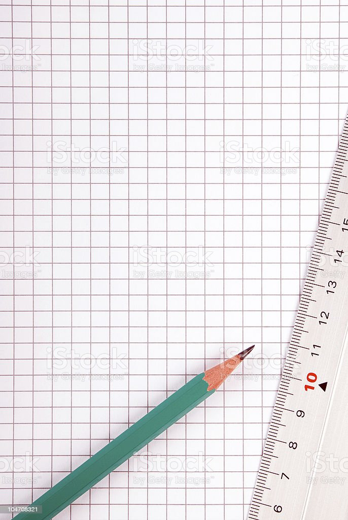 squared paper and pencil with ruler royalty-free stock photo