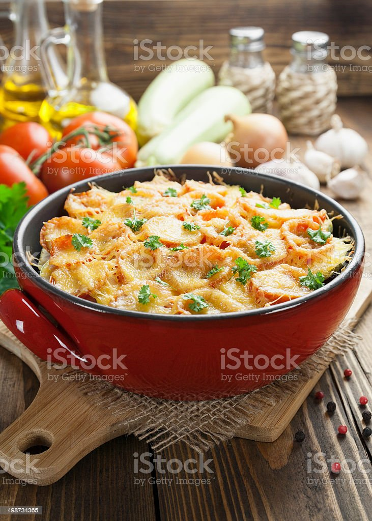 Squash baked with tomato and cheese royalty-free stock photo