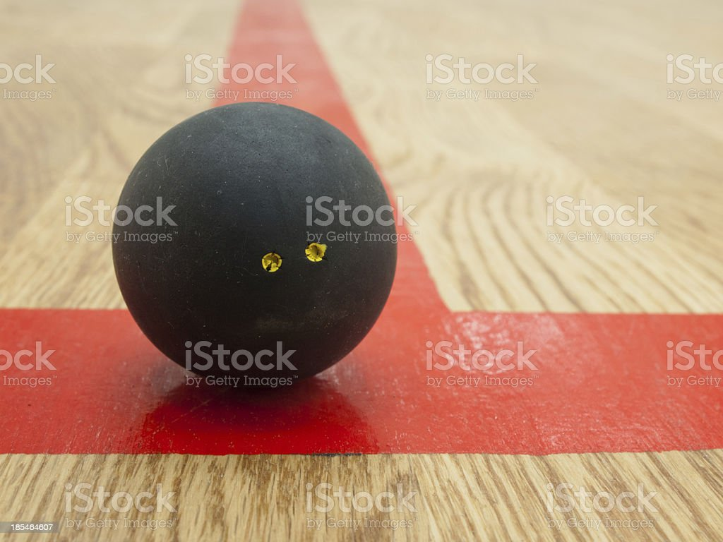 Squash ball on t-line. stock photo
