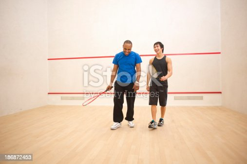 two friends finish a game of squash