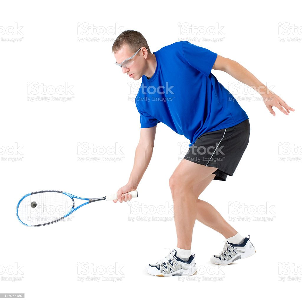 Squash player hitting the ball with his racket stock photo