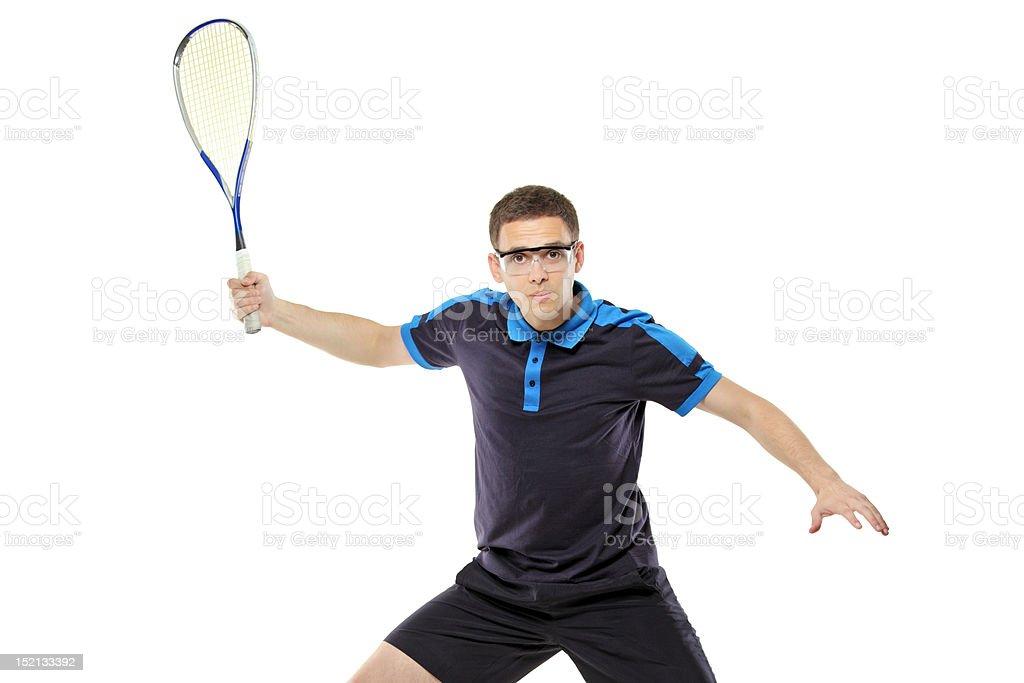 Squash player posing against white background stock photo