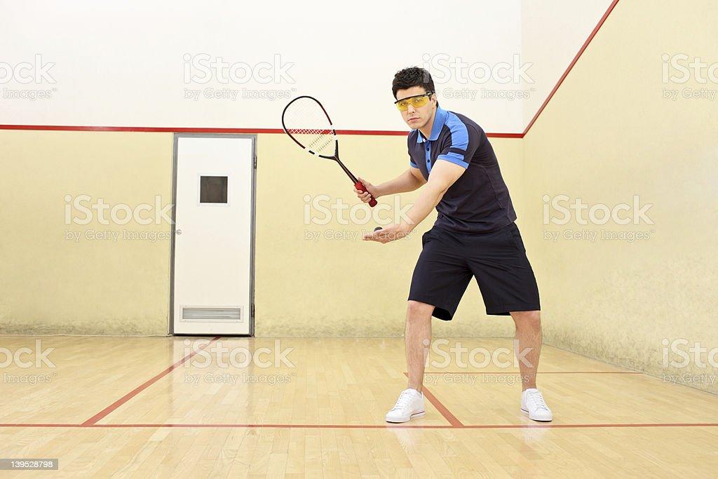 Squash player serving a ball stock photo