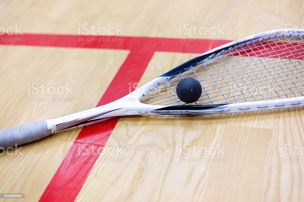 squash racket and ball on the court stock photo