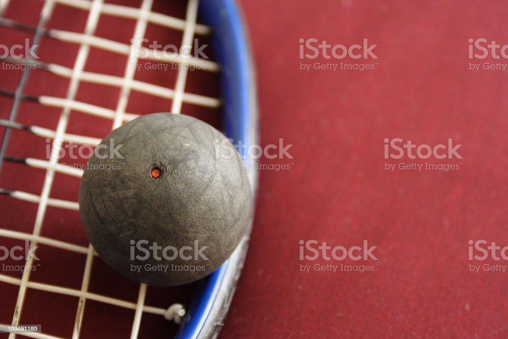 Squash racket and Ball stock photo