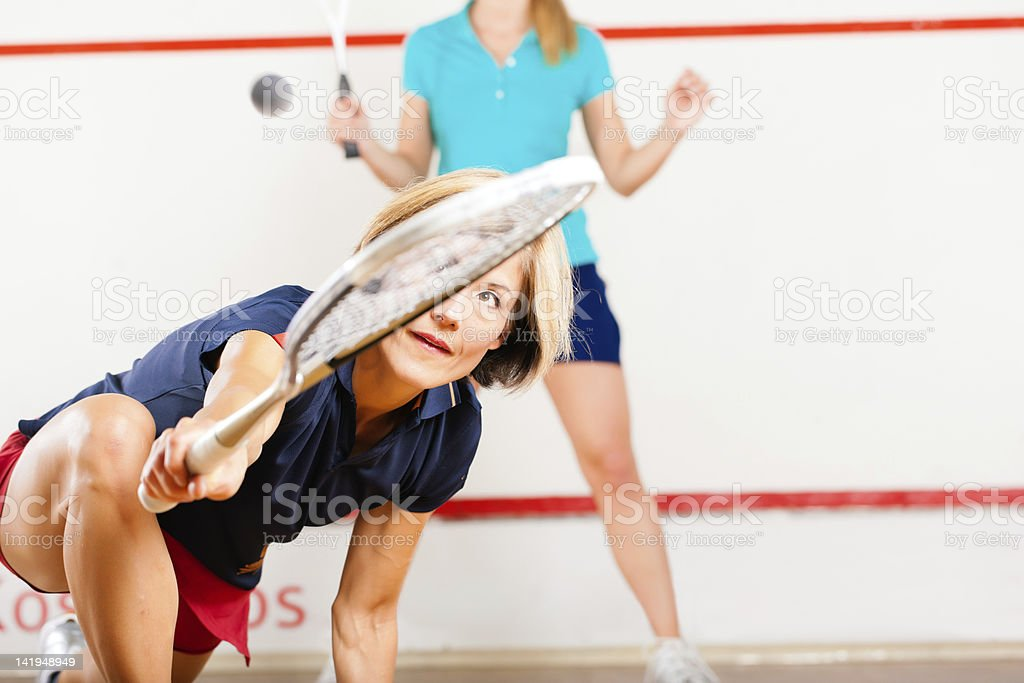 Squash racket sport in gym royalty-free stock photo