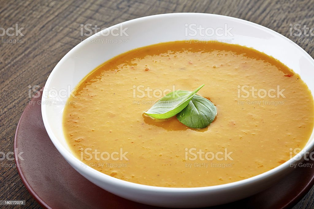 squash soup with basil leaf royalty-free stock photo