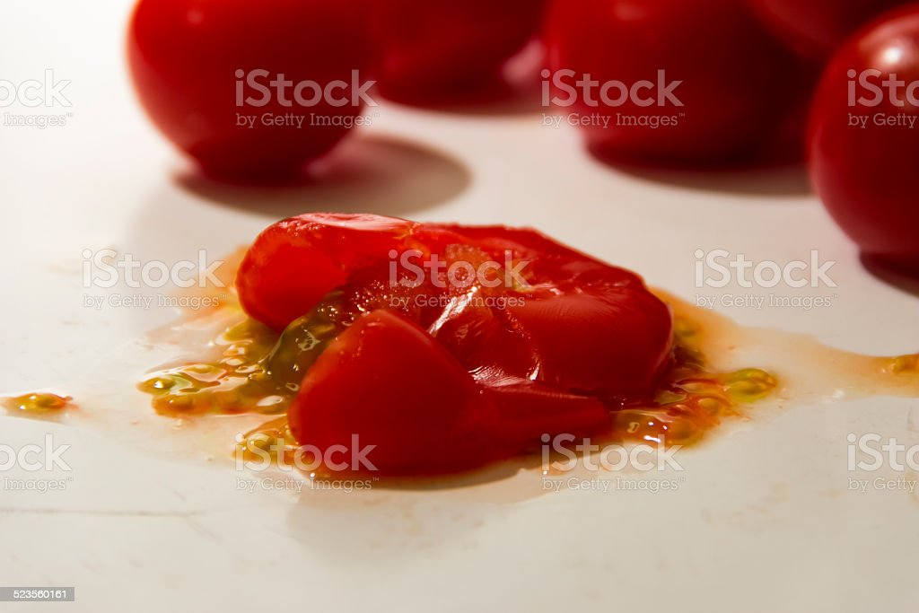 squashed tomato stock photo