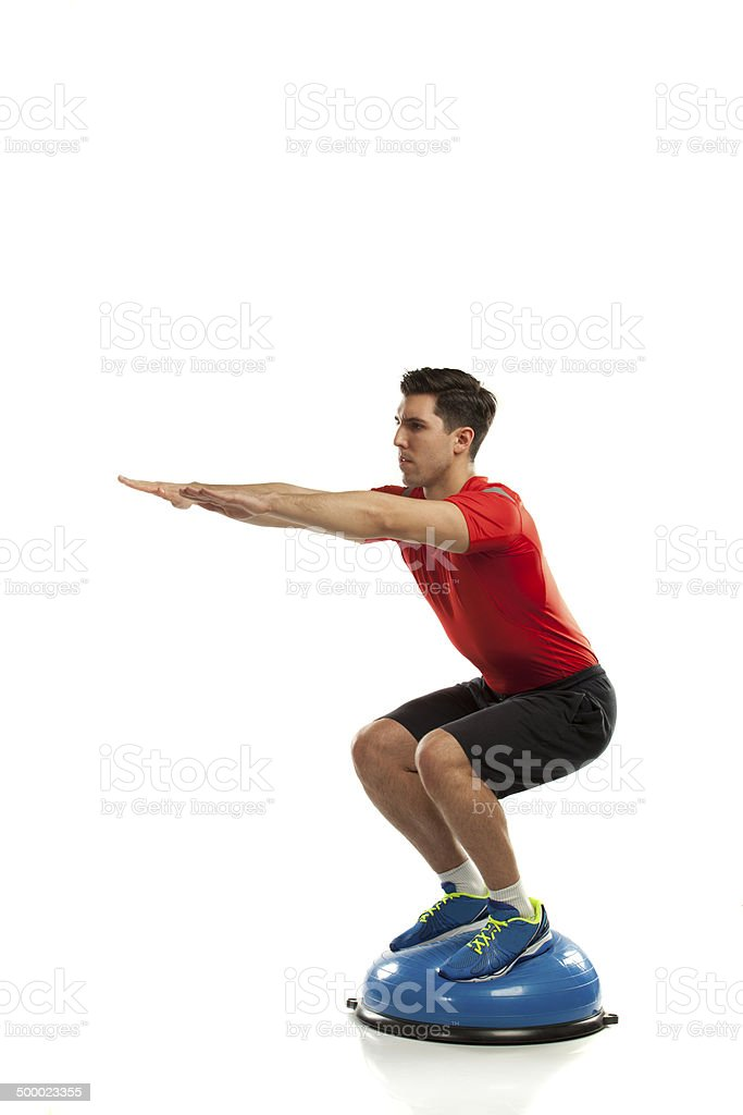 squat exercise on ball stock photo