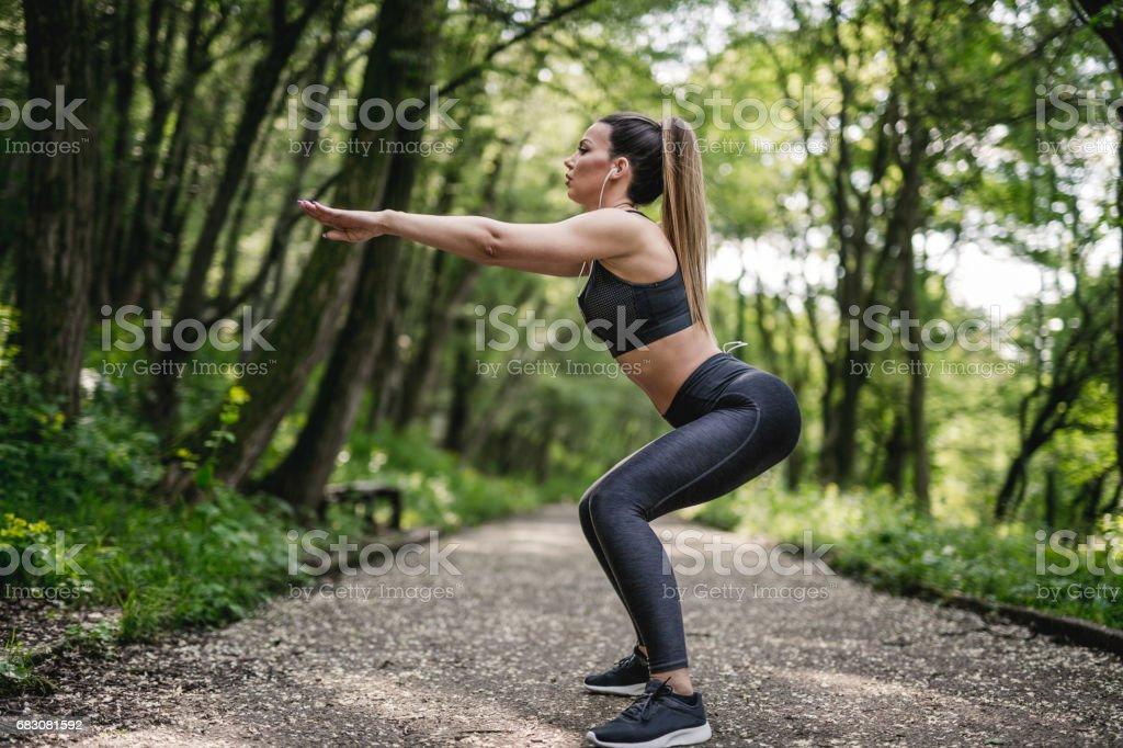 Squat exercise stock photo