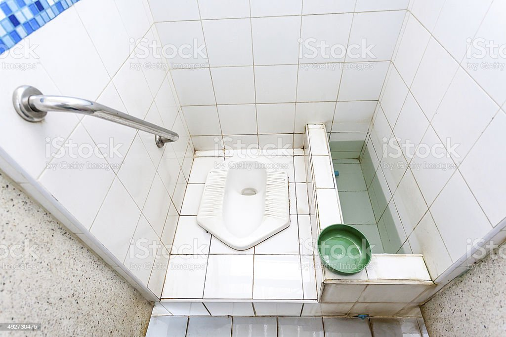 Squat toilet stock photo