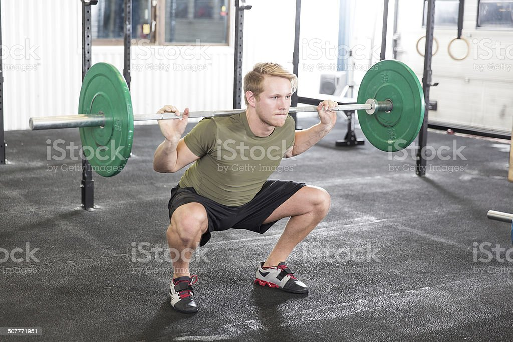 Squat workout at fitness gym center stock photo