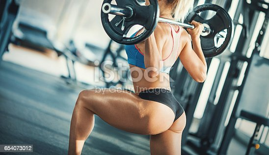 670937518istockphoto Squat workout. 654073012