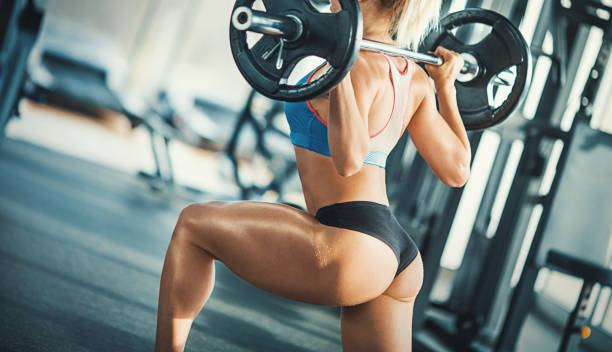 Squat workout. stock photo