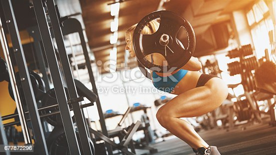 670937518istockphoto Squat workout. 677872296