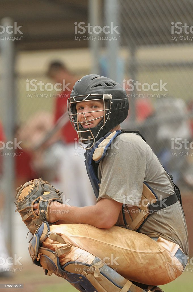 Squatting baseball catcher stock photo