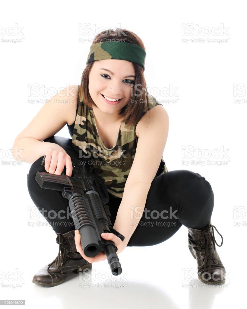 Squatting Gun Totter stock photo