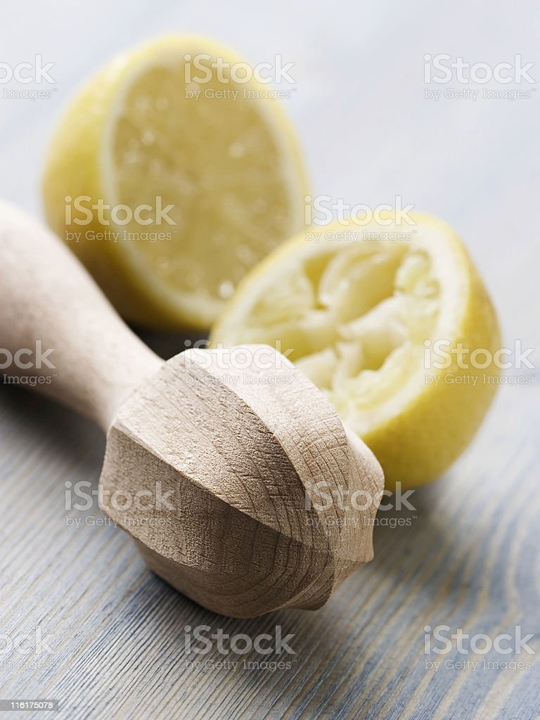 Squeezer and lemons royalty-free stock photo