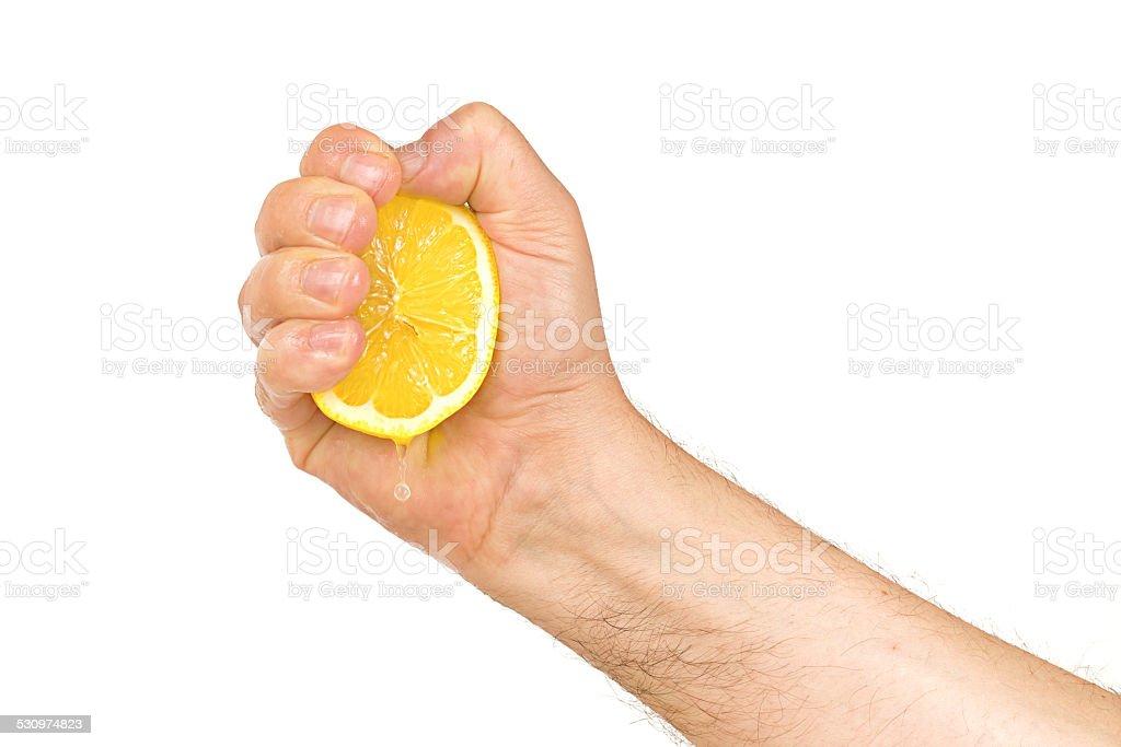 squeezing a lemon stock photo