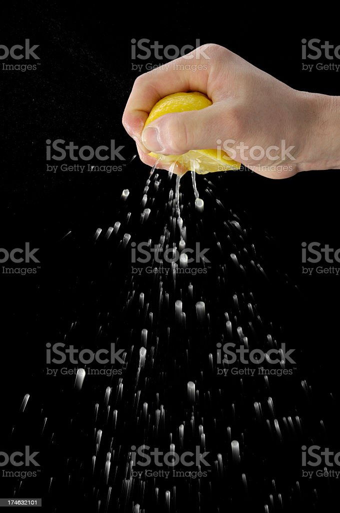 Squeezing Lemon stock photo