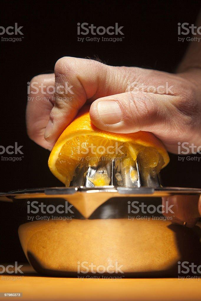 Squeezing Orange royalty-free stock photo