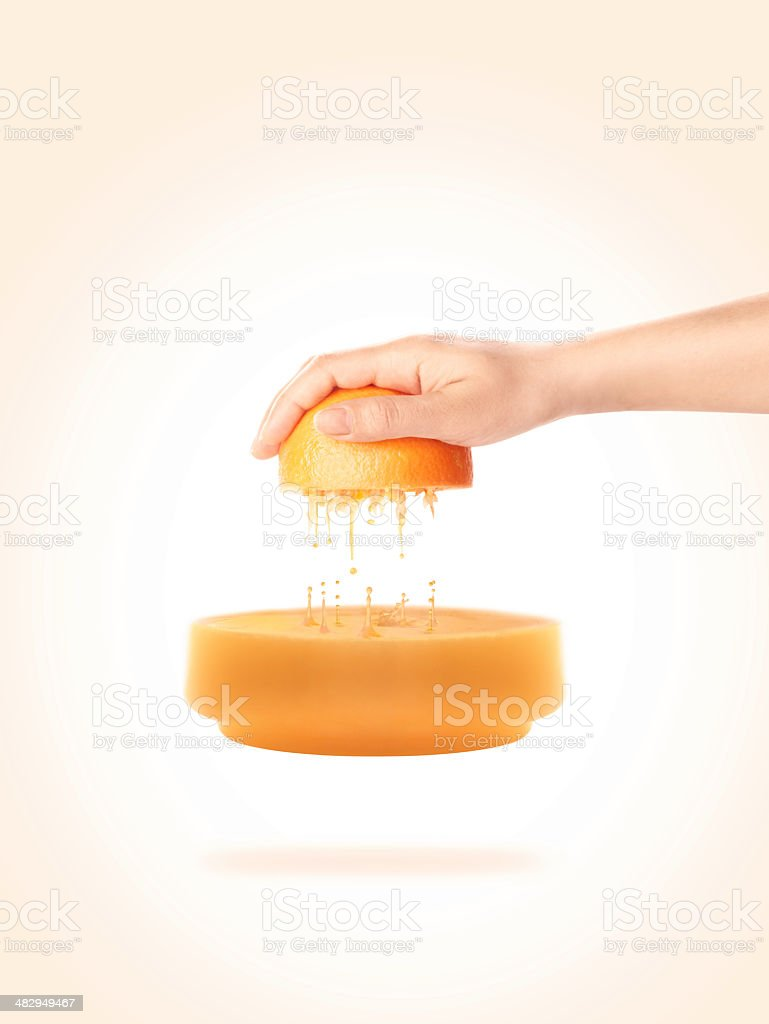Squeezing Orange without Juicer stock photo