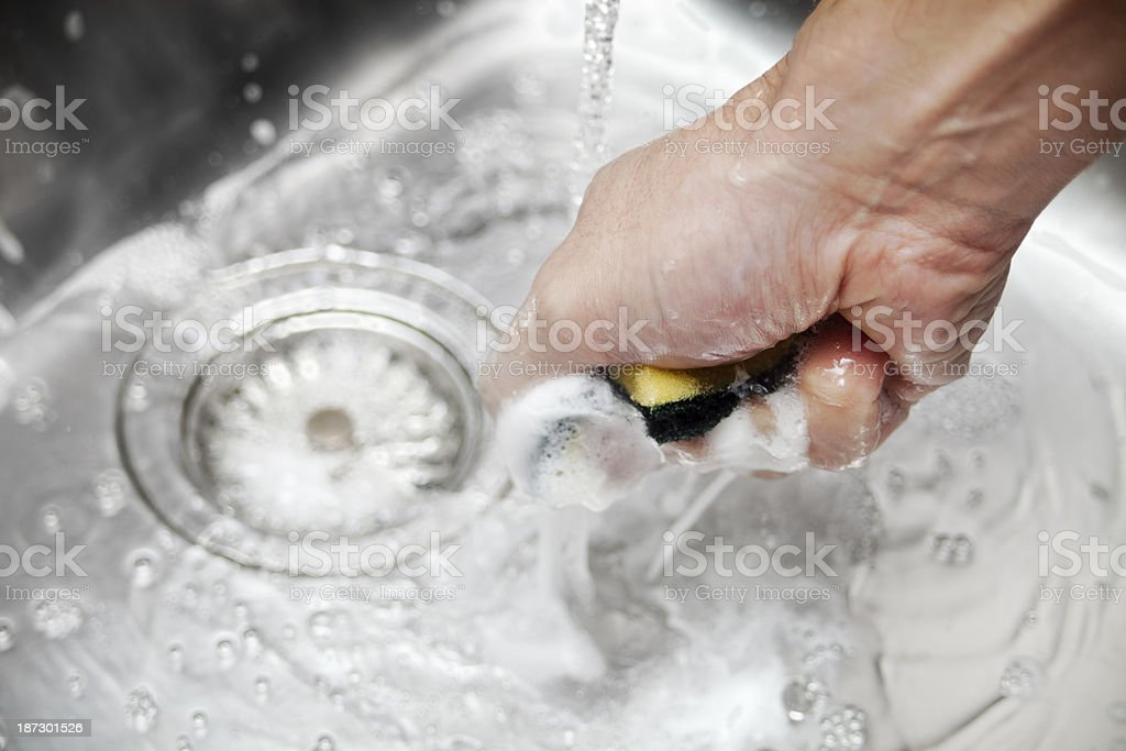 Squeezing the scourer royalty-free stock photo