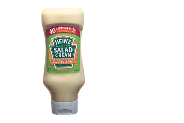 squeezy bottle of reduced fat heinz salad cream - heinz stock photos and pictures