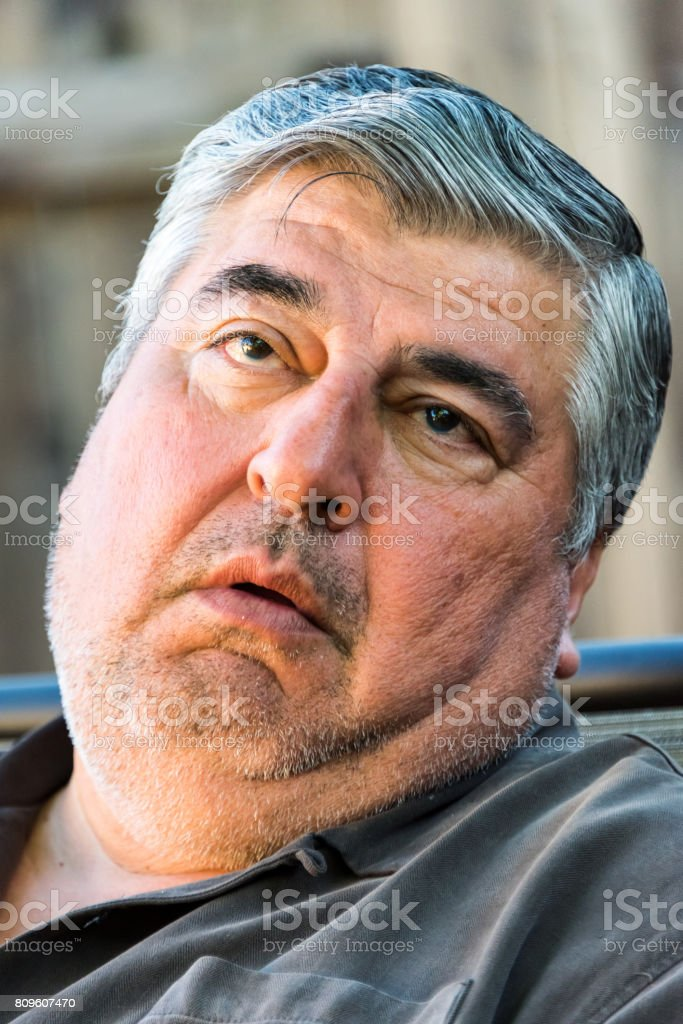 Squinting Mature man stock photo