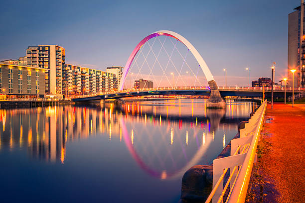 "Squinty Bridge, Glasgow The Finnieston Bridge over the River Clyde in Glasgow - also known as the Clyde Arc and, less formally, the ""Squinty Bridge"" - at night. theasis stock pictures, royalty-free photos & images"