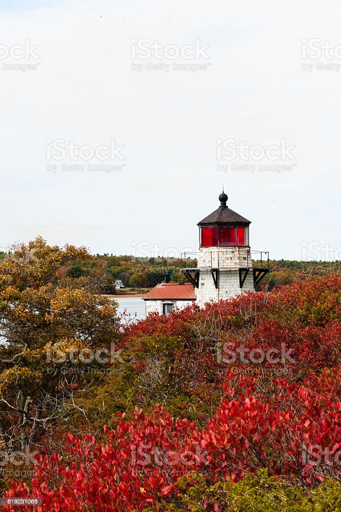 Squirrel Point Lighthouse, Arrowsic, Maine with bright fall foliage stock photo
