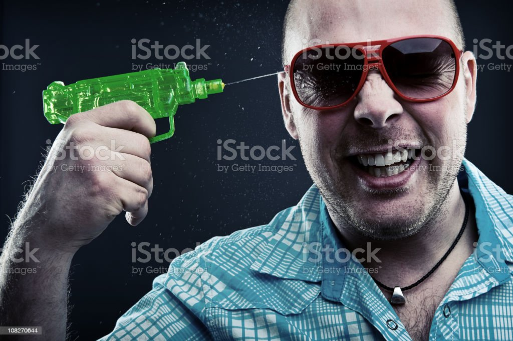 Squirt Gun suicide stock photo
