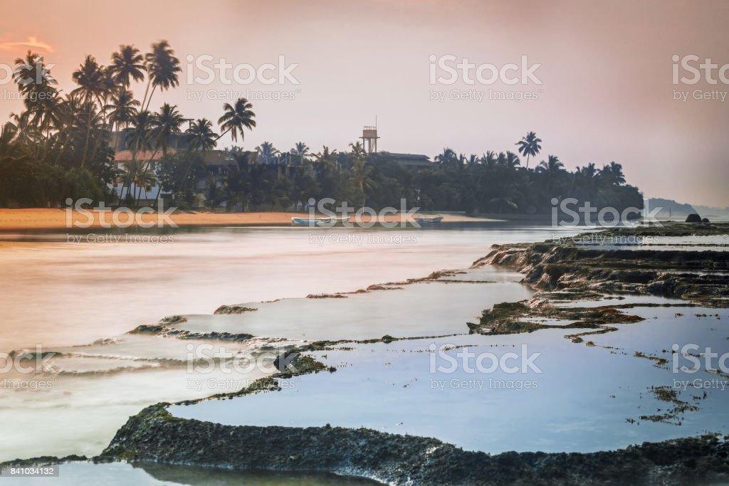 Sri Lanka. Beruwela. Coral reefs near the shore with palm trees stock photo