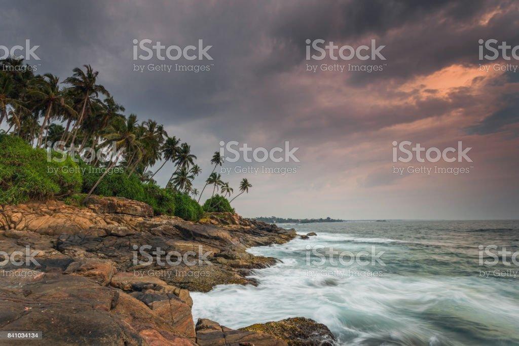 Sri Lanka. Beruwela. Stone ocean shore at sunset stock photo