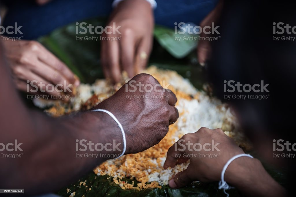 Sri Lanka: family members eating with their hands stock photo