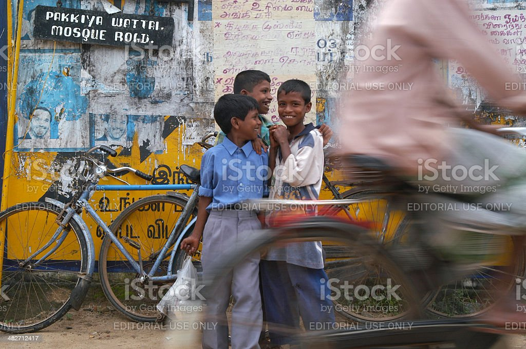Sri Lankan Children Stand on Busy Bicycle Street stock photo