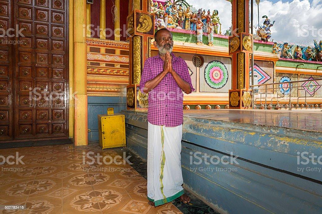 Sri Lankan Man in Front of Muthumari Amman Temple stock photo