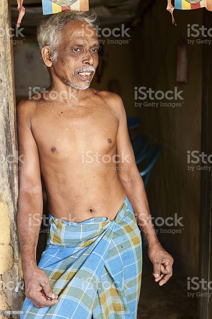 Sri Lankan man preparing cinnamon sticks royalty-free stock photo