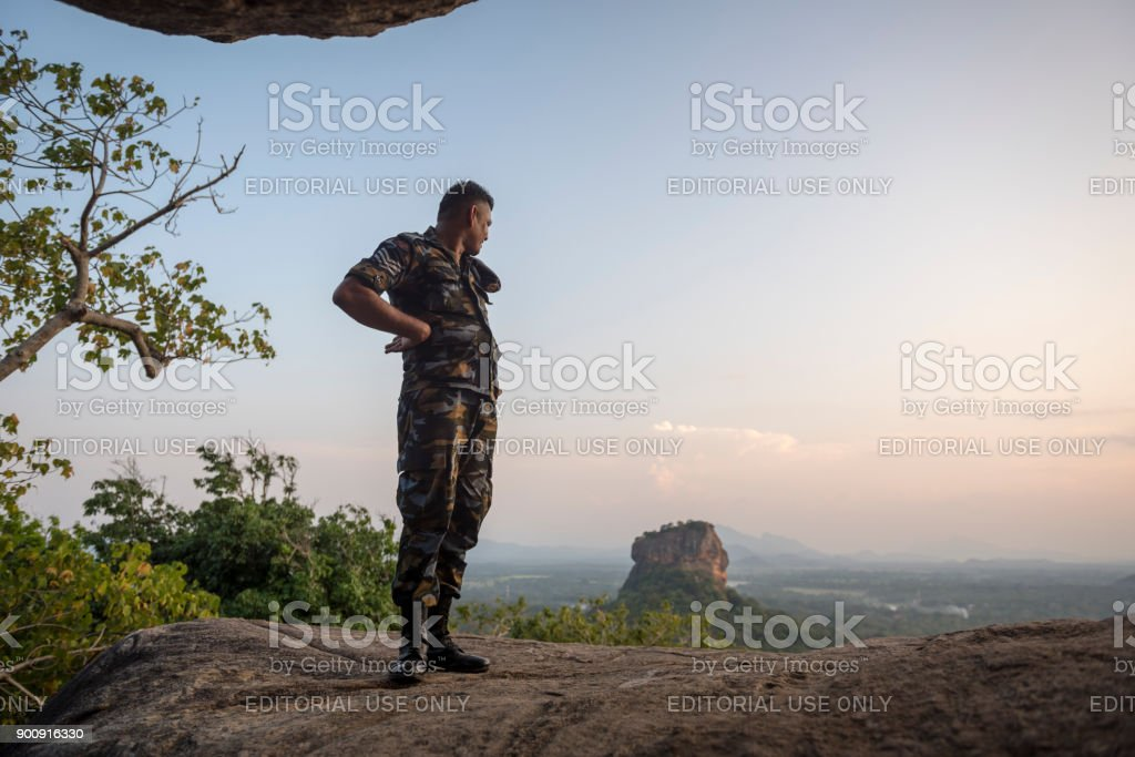 Sri Lankan military and Sigiriya rock fortress stock photo