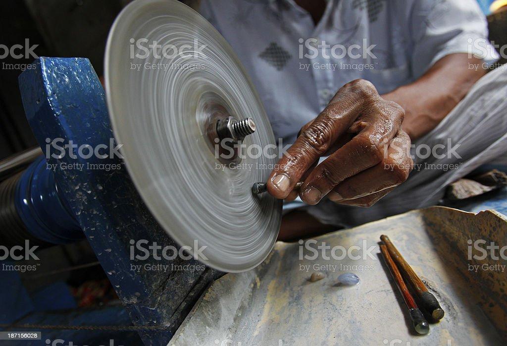 Sri Lankan miner cuts a gem stock photo