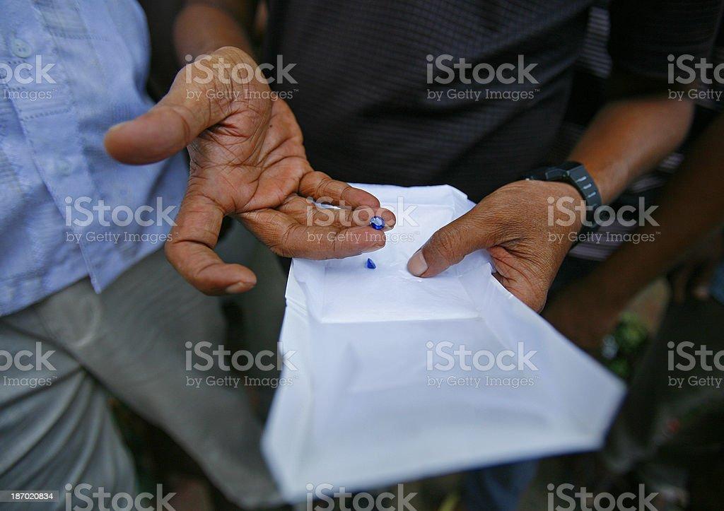 Sri Lankan miner holds gem stock photo