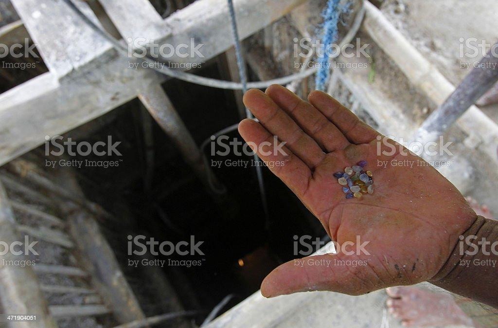 Sri Lankan miner holds gems stock photo