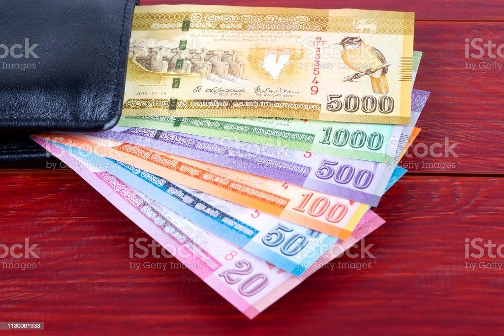 黒の財布でスリランカ ルピー - インド通貨のストックフォトや画像を ...