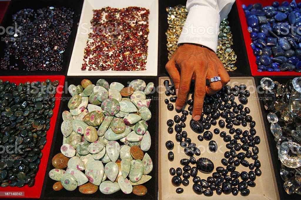 Sri Lankan store worker examines a gem stock photo